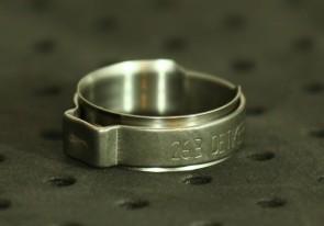 Opaska zaciskowa z wewnętrznym pierścieniem (wkładką) 23-25,6mm szer.9,2mm