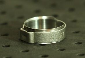 Opaska zaciskowa z wewnętrznym pierścieniem (wkładką) 21-23,8mm szer.9,2mm