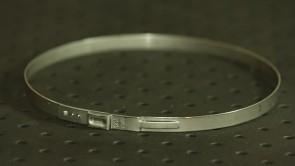 Opaska zaciskowa z zamkiem mechanicznym 117,3-120,5mm szer.7mm