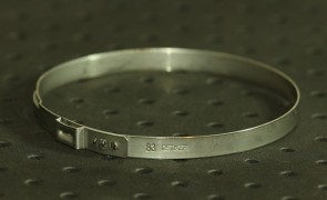 Opaska zaciskowa z zamkiem mechanicznym 79,8-83mm szer.7mm